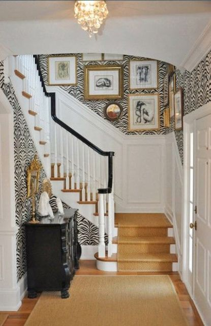 zebra print wallpaper for a glam and refined entryway and a warm colored stair runner