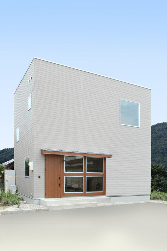 The house has a relatively small footprint, it's clad in white and there are lots of windows spotted here and there