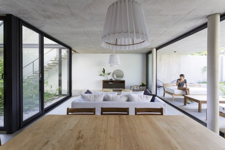 The living area is squeezed between the interior garden and a covered outdoor lounge space