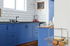 08 a bold blue kitchen with white subway tiles and black grout to stand out