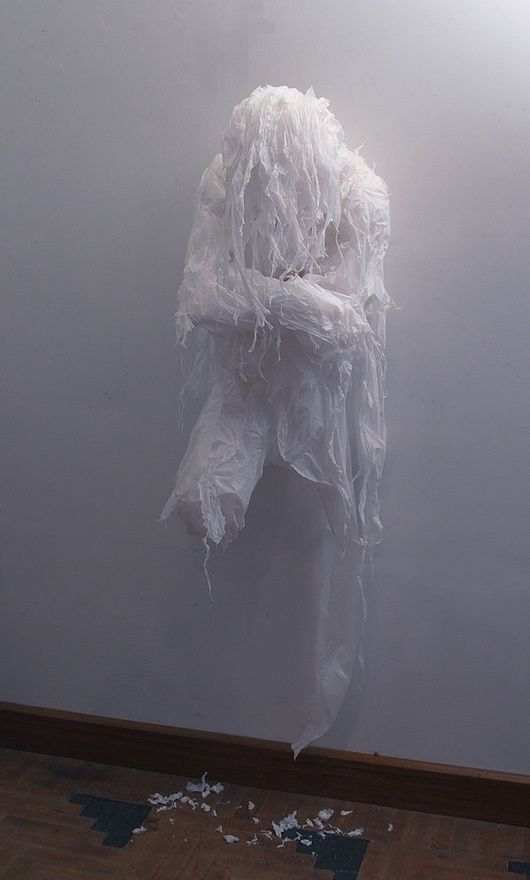 a wall ghost of shredded trash bags is a creative and very scary idea