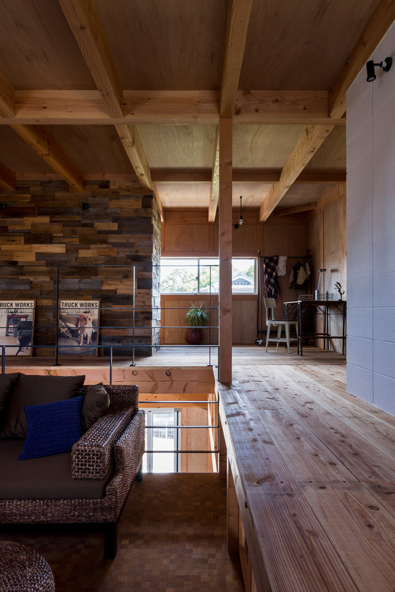 You can see a small workspace in the corner of the house and wood beams on the ceilings