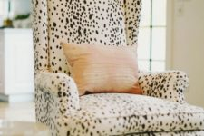09 a cozy dalmatian print upholstered chair is a great idea for sprucing up the interior