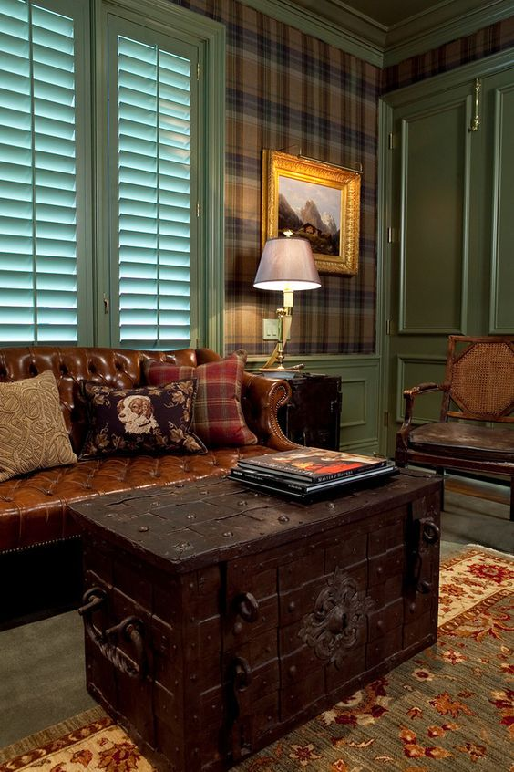a dark-colored vintage chest as a coffee table for a traditional and masculine living room