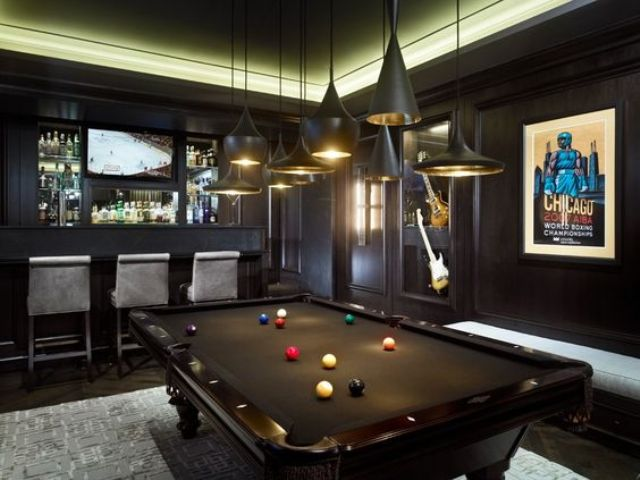 modern dark man room with a home bar and a pool table - who needs more than that