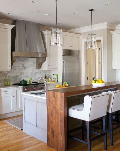 the kitchen island fits kitchen decor, and a wood countertop on it fits the space around it