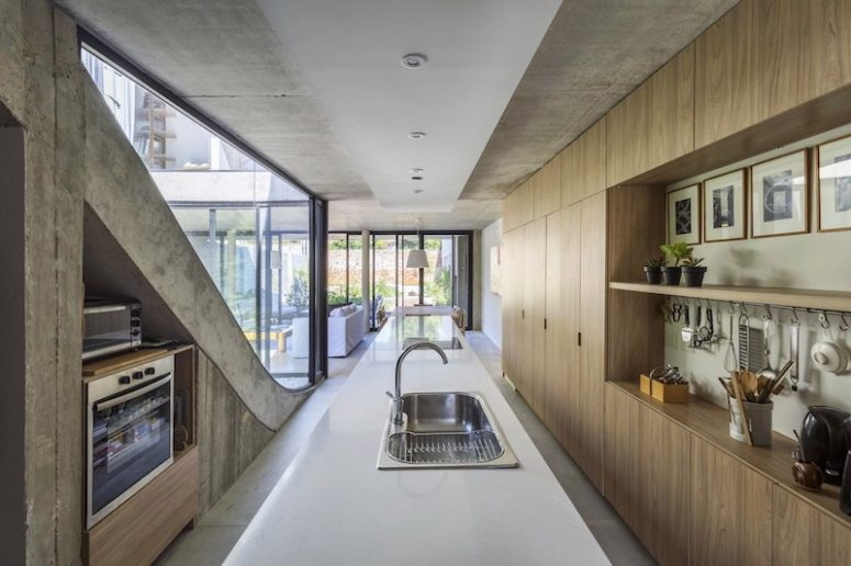 The materials are basic and pure, and everything is centered around the cool garden views and courtyard