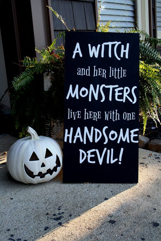 a black and white sign with a funny quote and a black and white pumpkin
