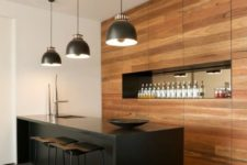 10 a black kitchen island doubles as a kitchen countertop, and it stands out in decor