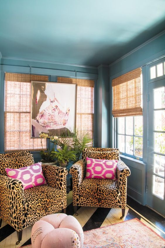 cheetah print chairs make this pastel space more interesting