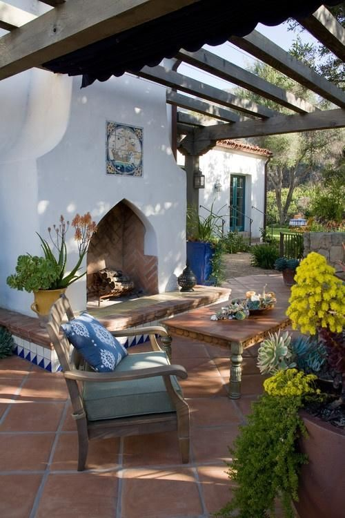 the terrace is done with a white hearth decorated with azulejo tiles and rough wood furniture
