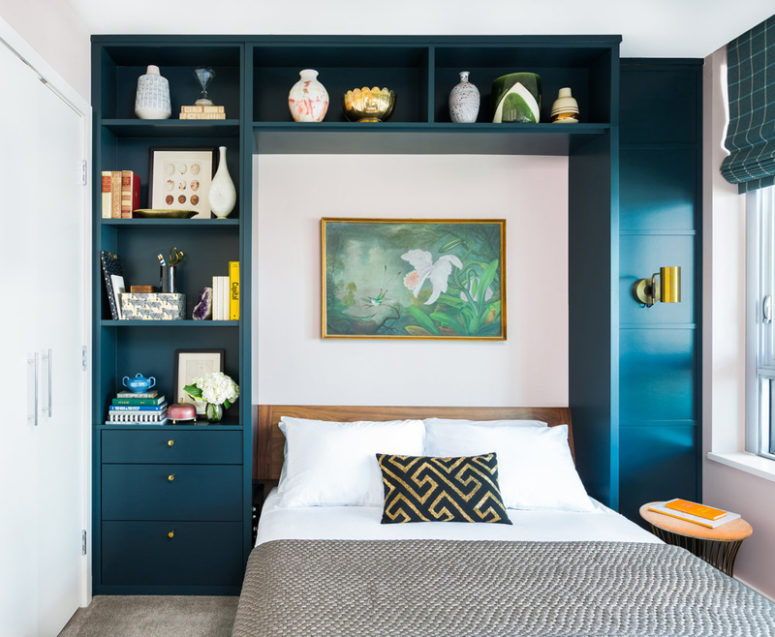 The guest bedroom is also done with a navy shelving unit around the bed