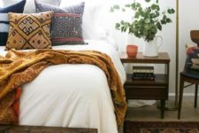 12 a comfy printed blanket and a neutral bed cover will make your guest feel comfy even if it's cold