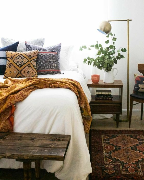 a comfy printed blanket and a neutral bed cover will make your guest feel comfy even if it's cold
