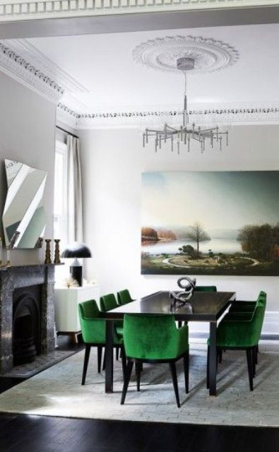 a cozy neutral dining room with bold emerald upholstered chairs that make a statement