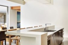 12 a modern space with a minimalist feel is completed with a sleek white countertop