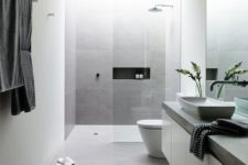 12 large scale matte grey tiles for a peaceful minimalist bathroom