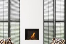 12 zebra print chairs add interest to a neutral fireplace space