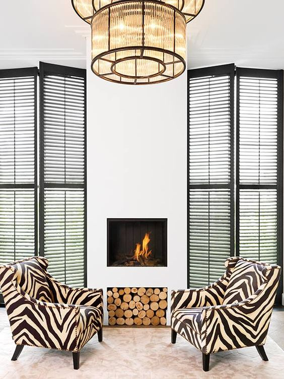 Zebra Print Chairs Add Interest To A Neutral Fireplace Space