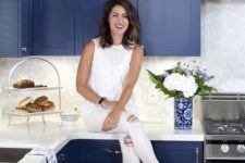 13 a bold cobalt blue kitchen with white countertops and marble tiles looks chic