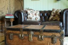 13 a vintage wooden trunk accentuates this living room and doubles as a coffee table and a storage
