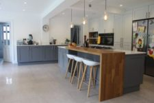 13 the kitchen island with a bar countertop has two parts – a cooking zone for the kitchen and a wooden countertop for eating