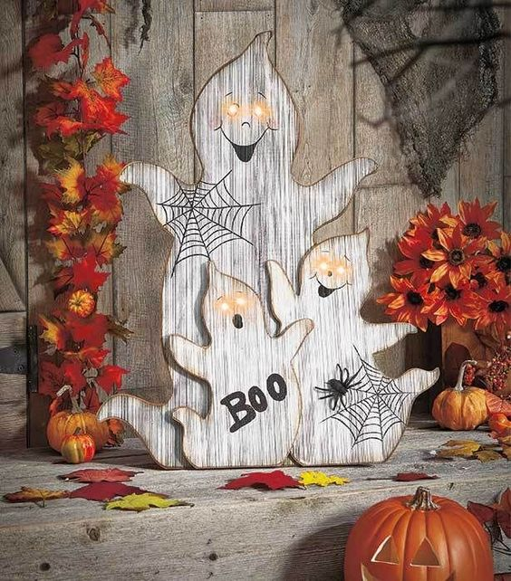 wood cut ghosts with webs, letters and lit up eyes for outdoor or indoor decor