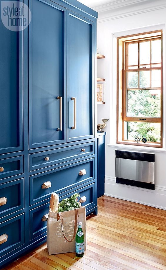Parisian bistro-inspired kitchen with vibrant blue cabinets