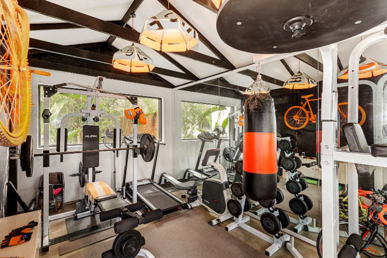 There's a private gym made with yellow and orange touches