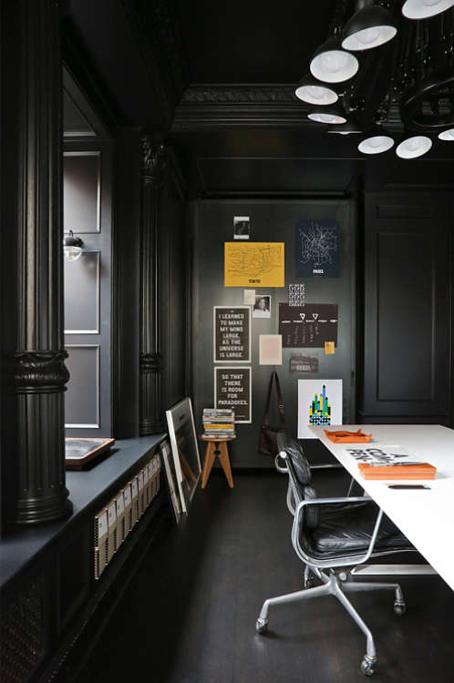 There's also a home office done in black with colorful details that enliven the space