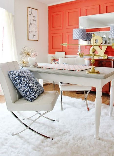a girlish home office with a fiery red statement wall with molding