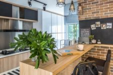14 a wooden kitchen island in a modeern space is made chic with brown leather stools