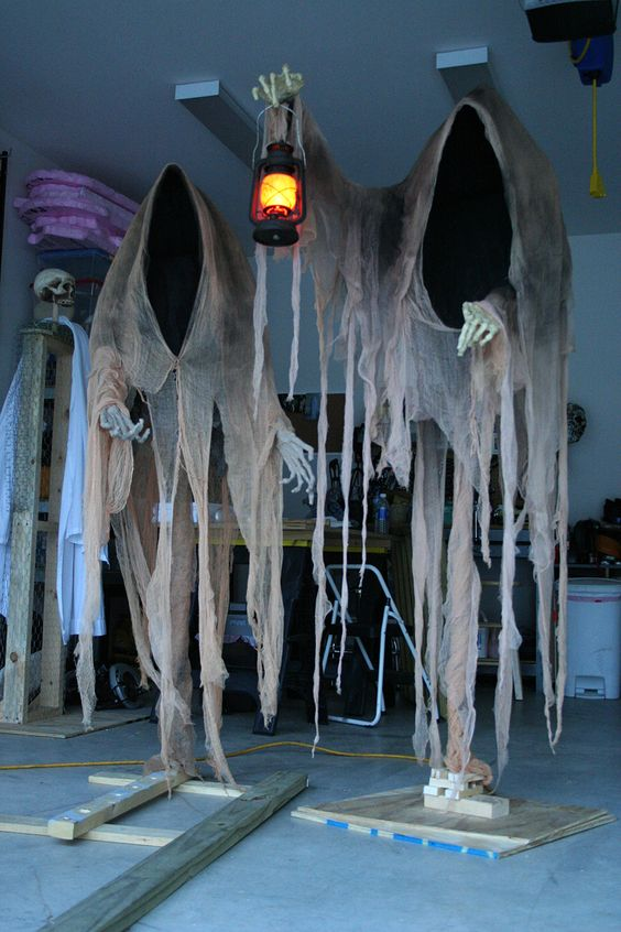 dark-colored cheesecloth ghosts with a lantern will find a way to your outdoor space