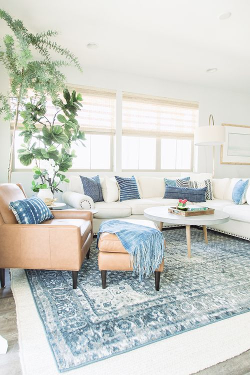 a large white sectional sofa is made trendier with shibori pillows
