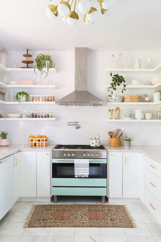 a mint colored cooker makes a soft colorful statement in this neutral space