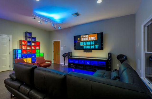 a modern video game room will accomodate all your friends and will look very inviting