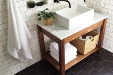 15 matte black hex tiles on the floor and matte white subway tiles with black grout for an elegant bathroom