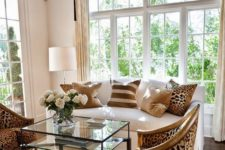 16 cheetah print upholstered chairs and pillows add eye-catchiness to a neutral living room