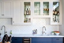 16 suspended white cabinets and cobalt blue ones on the floor create a light airy look