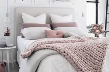 17 a chunky knit blanket matches the pillows and with a duvet provides enough warmth for cold ights