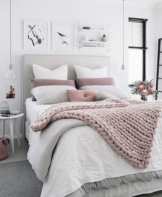 a chunky knit blanket matches the pillows and with a duvet provides enough warmth for cold ights