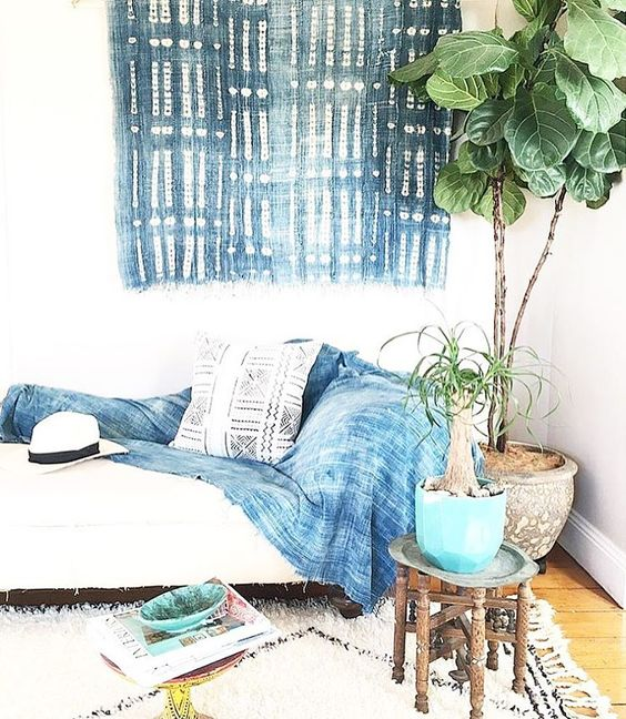 a shibori blanket and a wall hanging to make the room more eye-catching