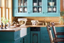 17 turquoise blue cabinets in vintage style and lots of natural wood for a rustic feel