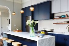 18 a dark blue modern sleek kitchen with white marble and white cabinets