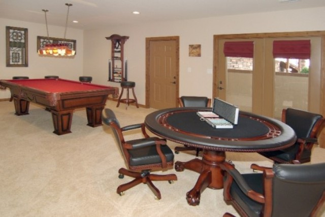 a poker table and a modern pool table are right what you need to have fun with your guests