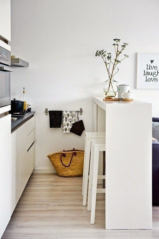 a sleek white countertop won't take much space and will look airy, which is great for small spaces