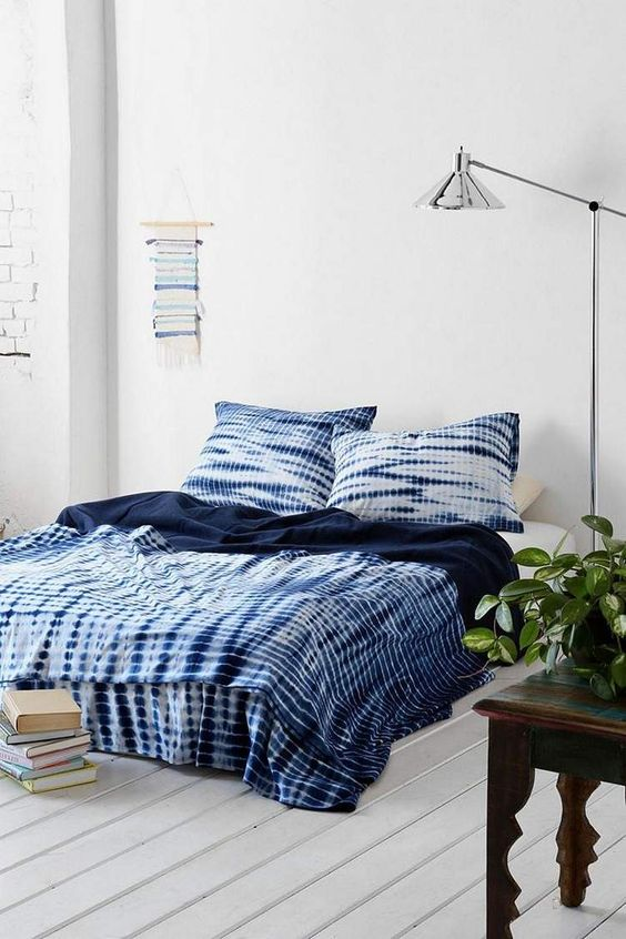 bring a trendy and edgy feel to your neutral bedroom with sibori bedding