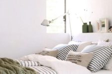 18 comfortable bedding of natural fabrics and an additional crochet blanket