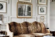 18 panelling, a gallery wall and a refined cheetah print sofa look very traditional and chic