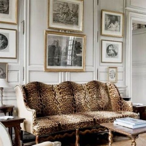 panelling, a gallery wall and a refined cheetah print sofa look very traditional and chic